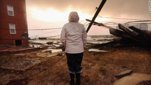 Atlantic City, New Jersey, resident Kim Johnson inspects the area around her flooded apartment building on Tuesday.