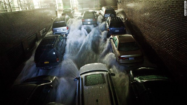 Water pours over cars in Manhattan as superstorm Sandy flooded large parts of the island on Monday, October 29. 2012. The storm surge from Sandy set records in lower Manhattan, where flooded substations caused a widespread power outage. <a href='http://www.cnn.com/2012/10/29/us/gallery/ny-braces-sandy/index.html'>View photos of New York bracing for impact.</a>