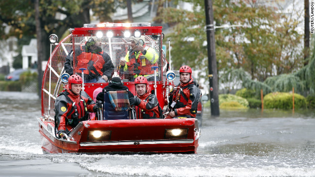 Rescue workers use a hovercraft to rescue a resident using a wheelchair from floodwaters in Little Ferry, New Jersey, on Tuesday.