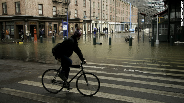 Superstorm Sandy left New York's South Street Seaport flooded and covered in debris on Tuesday.