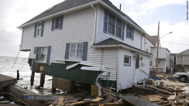 A home badly damaged by Superstorm Sandy sits along the shoreline in Milford, Connecticut, on Tuesday.