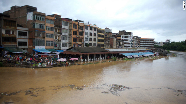 A market is half-submerged in Beiliu, China, on Tuesday. 