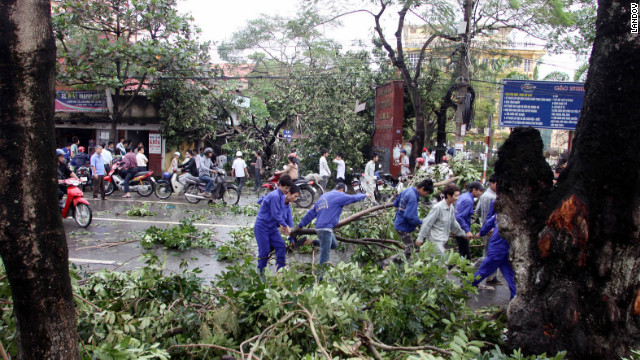 People clear debris in the wake of the storm. 