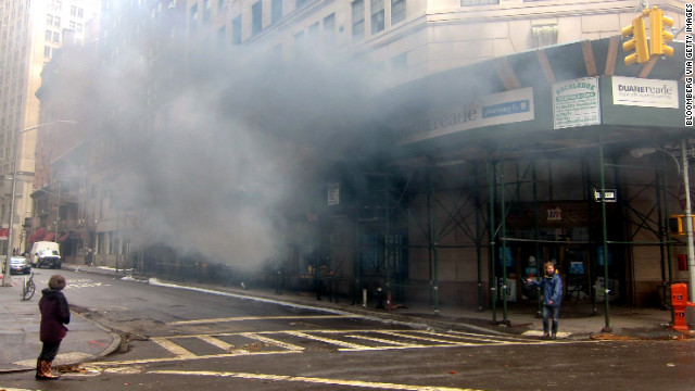 A malfunctioning generator billows black smoke at a building in New York on Tuesday.