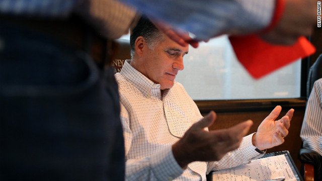 Romney talks with advisers on his campaign bus while en route to a rally at Avon Lake High School on Monday, October 29, in Avon Lake, Ohio.