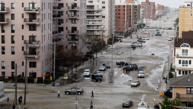 West Broadway in Long Beach is covered in beach sand due to flooding from Hurricane Sandy on Tuesday.