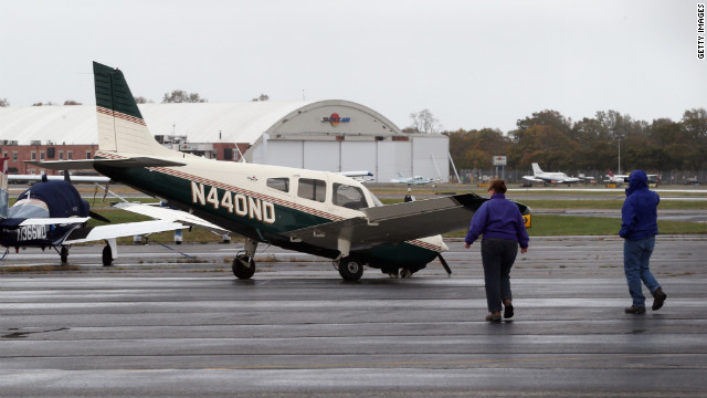 A small plane damaged in the storm sits on a runway in Farmingdale, New York, on Tuesday.