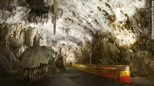 An electric train carries visitors on a two-mile route through Slovenia's Postojna Cave.