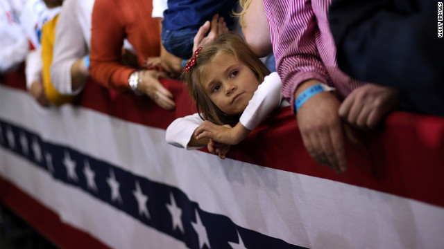 A young girl looks on during a campaign rally for Romney at Avon Lake High School on Monday.