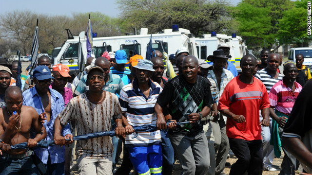 Police fire tear gas as striking platinum miners protest in South Africa