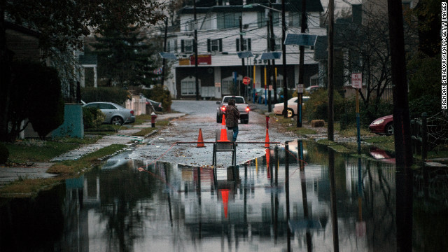 A man stands near a homemade road block on Tuesday in Little Ferry, New Jersey.