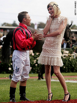 Actress Kate Bosworth chats to jockey Chris Munce at the 2006 carnival. The mild Australian climate means punters aren't obliged to wear jackets and gloves.
