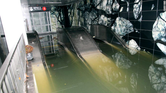 A subway station and escalator sit underwater in New York on October 30 in the aftermath of Superstorm Sandy.