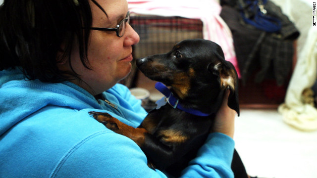 Long Neck, Delaware, resident Kim Levan and her dog Charlie take shelter at Cape Henlopen High School in Lewes, Delaware as Hurricane Sandy approaches.