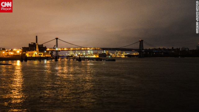  CNN iReporter Jordan Shapiro captured this view of the Williamsburg Bridge in New York at 11 p.m. on Tuesday, October 30. Half of the bridge and Brooklyn is lit, while the Manhattan side and the surrounding part of the island remain shrouded in darkness.