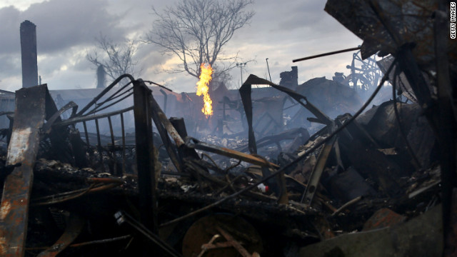 Firefighters continued to survey the damage in Rockaway on Wednesday. At least 80 homes were destroyed.