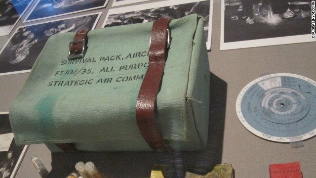 The survival kit issued to the bomber crew in &quot;Dr. Strangelove.&quot; Note the teeny tiny red book containing not just the Holy Bible, but a useful list of Russian phrases as well.