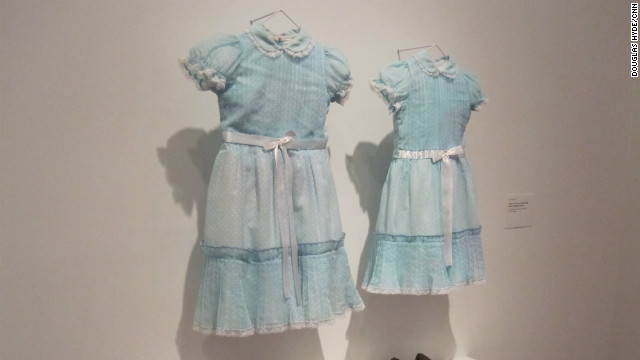 The blue dresses worn by the ghostly twins of &quot;The Shining&quot; are just as chilling off the movie set. 