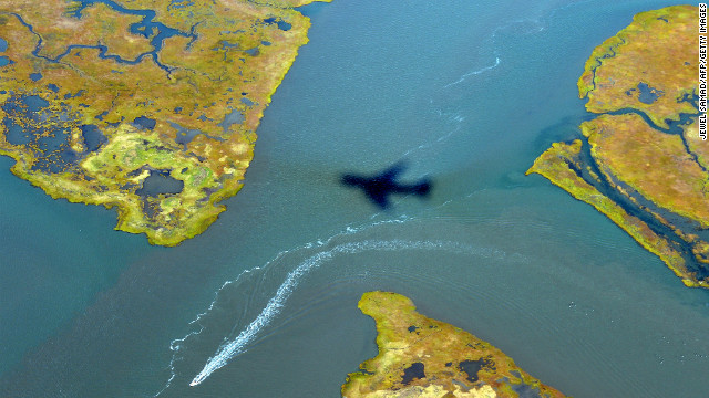 The shadow of Air Force One is cast on the water as it prepares to land in Atlantic City on Wednesday, October 31.