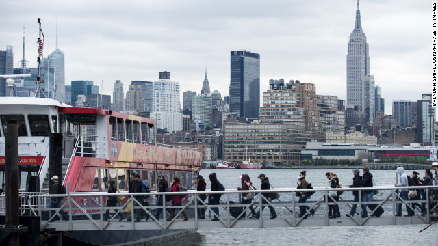People board the ferry, one of the few functioning transportation systems, in Hoboken, New Jersey, on Wednesday, October 31.