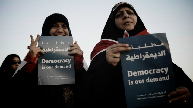 Bahraini Shiite Muslim women hold signs during an anti-government rally in the village of Shakhora on September 14.
