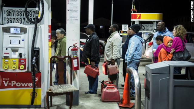 People wait in line to fill containers with gas at a Shell station in Edison, New Jersey, on Tuesday. Superstorm Sandy left much of Bergen County flooded and without power.