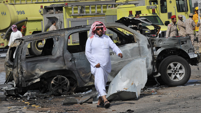 Saudi security forces inspect the destruction at the site where a gas tanker exploded on November 1, 2012.