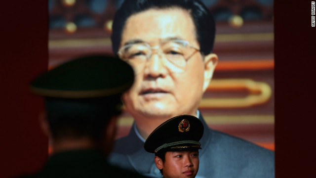  A paramilitary policeman passes by the portrait of China's President Hu Jintao at a state-sponsored exhibition in Beijing Tuesday.
