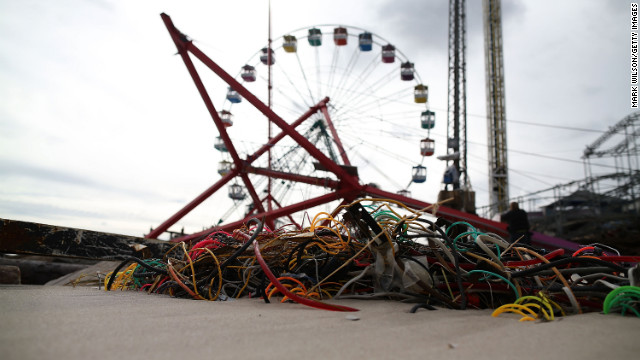 Amusement-park rides lie mangled on the beach after the Fun Town pier in Seaside Heights was destroyed.