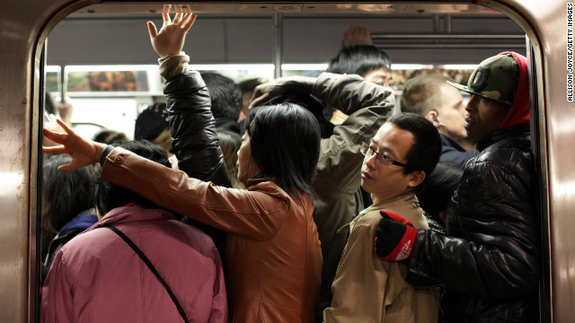 Commuters pack into a train on Thursday in New York City. Limited public transit has returned to the city, where 14 of 23 subway lines are running. 