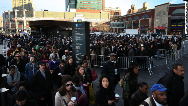 Thousands of people wait to board city buses into Manhattan, and some subway lines remain underwater. Getting water out of the tunnels is &quot;one of the main orders of business right now,&quot; Gov. Andrew Cuomo said Thursday.