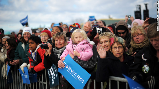 Supporters wait to hear President Obama during a campaign rally at Austin Straubel International Airport on Thursday.