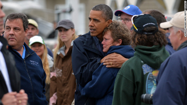 President Obama supports Donna Vanzant, the owner of the North Point Marina, which was damaged in the hurricane, during a tour through Brigantine, NJ this October 31, 2012