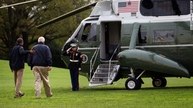 President Obama walks towards Marine One with FEMA Administrator Craig Fugate prior to his departure from the White House for a tour around storm-damaged areas of New Jersey.