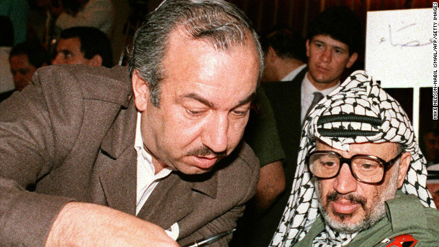 A picture taken on April 22, 1987 shows late Palestinian leader Yasser Arafat, consulting with Fatah military chief Khalil al-Wazir.