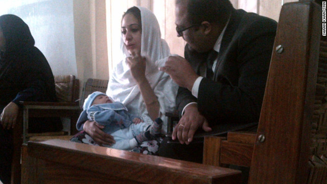 A British woman arrested for drug trafficking in Pakistan, has returned to her jail cell despite concerns for her baby's life.