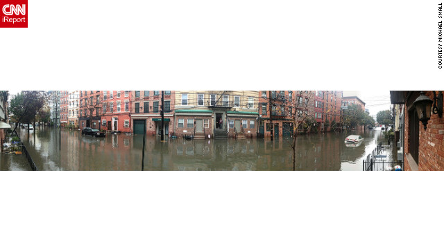 This panoramic photo from Hoboken was taken Tuesday. iReporter Michael Small was evacuated from Lower Manhattan and went to a stay with a friend in Hoboken. Hoboken flooded, lost power and the waters smelled &quot;like gas and chemicals,&quot; he said. He is now back in New York.