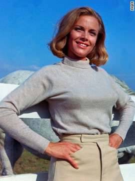 "Pilot Pussy Galore, played by Honor Blackman, claimed to be immune to Bond's charm in 1964's ""Goldfinger."" However, Galore eventually falls for 007."