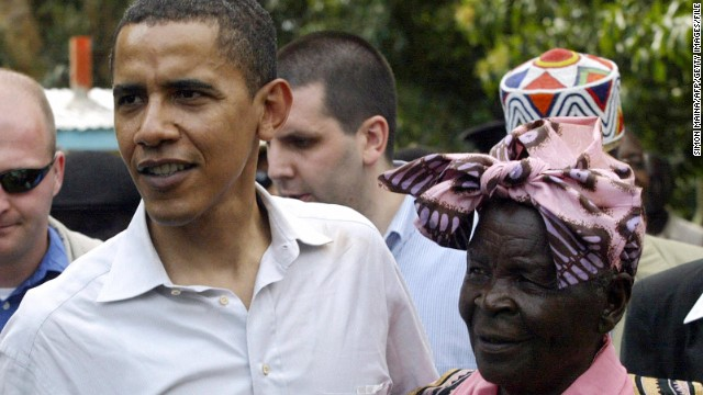 President Obama greets his grandmother, Sarah Obama, at her home in Siaya, Kisumu, Kenya, in 2006.