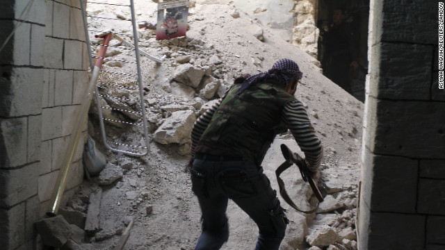 A member of the Free Syrian Army runs for cover from sniper fire in Aleppo on Friday.