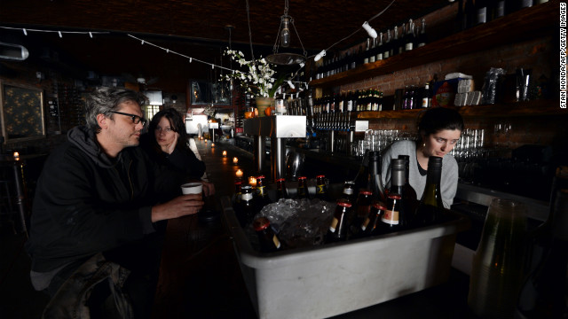 A barmaid works in New York City's Randolf Beer Restaurant, which used a generator to operate last week after the storm.