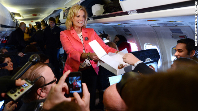 Ann Romney offers pastries to journalists aboard GOP presidential candidate Mitt Romney's campaign plane at Portsmouth International Airport in Newington, New Hampshire, on Saturday.