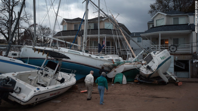Boats that were swept aground during Sandy sit against homes near a marina on Staten Island on Friday, November 2.