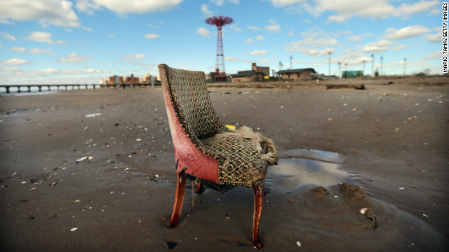 A damaged chair sits on the beach in low-lying Coney Island on Saturday.