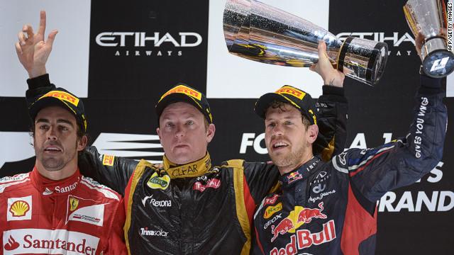 Fernando Alonso, left, and title rival Sebastian Vettel, right, with Abu Dhabi winner Kimi Raikkonen.