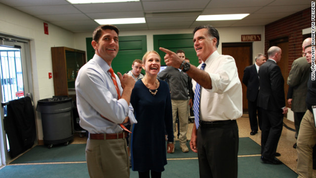 Romney and his running mate, Rep. Paul Ryan, and Ryan's wife, Janna, share a light moment before taking the stage for a rally in Celina, Ohio, on Oct. 28, 2012.