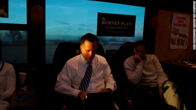 Romney and son, Craig, read aboard their campaign bus in Etna, Ohio, on Nov. 2, 2012.