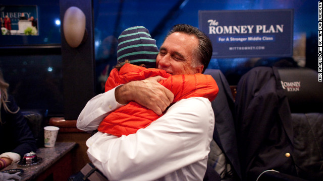 Romney hugs his grandson, Parker, inside his campaign bus after arriving in West Chester, Ohio, on Nov. 2, 2012. 