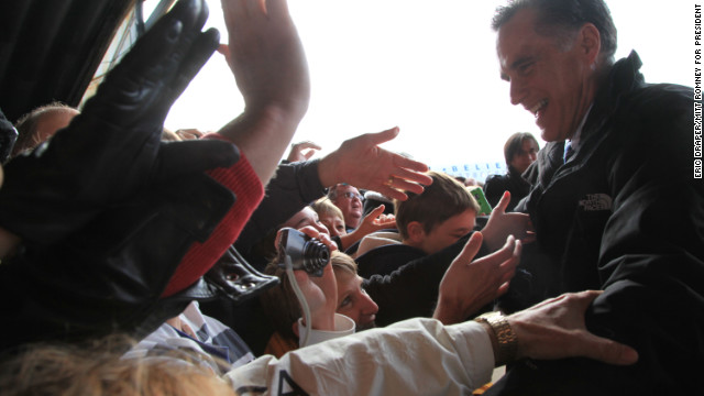 Romney greets supporters at an airport rally in Dubuque, Iowa, on Nov. 2, 2012.