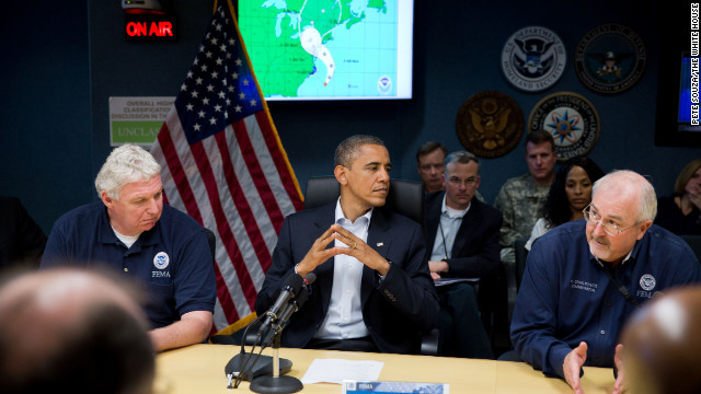 Obama, seated between FEMA Administrator Craig Fugate (r) and Richard Serino, FEMA deputy administrator, (l) receives an update on the response to Hurricane Sandy at the National Response Coordination Center at FEMA headquarters in Washington on Oct. 28, 2012.